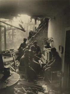 Russian soldiers playing piano in a wrecked living room in Berlin, 1945