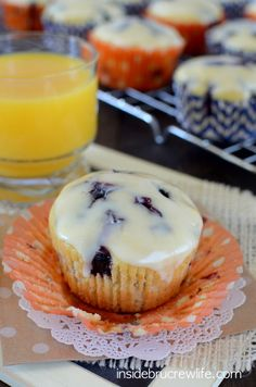 Orange Blueberry Muffins by insidebrucrewlife: Light delicate orange muffins filled with lots of fresh, juicy blueberry bites. #Muffins #Orange #Blueberry