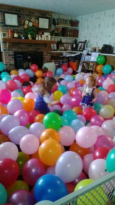 450 balloons, a few toddlers and the most awesome 2nd birthday party ever.  I used a baby fence to leave a balloon free path for adults to be near at hand, then later used the fence to corral balloons and make them deeper. My two year old loves crawling under them.  $50 in balloons. I do suggest using an air compressor to save your lungs.