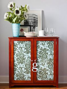 Fabric Redo Too much clutter for glass cabinet doors? Hide the cabinet's contents by lining the glass panels with patterned fabric. On the back of each door, stretch the fabric over the glass and use a staple gun to fasten the edges to the wooden frame. For a tidy appearance inside, conceal the staples by gluing coordinating ribbon.