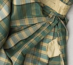 "watch pocket - sleeve detail - 1850s silk taffeta dress, included  button-in long sleeves, wide neckline adjustable with drawstrings, sleeves ruched at top and trimmed with silk fringe at hem, dress has back hook & eye closure, bodice boned, lined with ecru linen, skirt has small watch pocket in side front seam, hem faced with wide border of polished green cotton & green braid at hem, bust: 32""; waist: 22""; shoulder to hem: 56""; shoulder to waist: 12.5"""