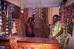 AFRICA, GHANA - Inside a Kente cloth shop, the colours and patterns are overwhelming. Each colour and pattern is representative of some stature, or an emotion. Colour representations: Black -- maturation, intensified spiritual energy. Blue -- peacefulness, harmony and love. Green -- vegetation, pla