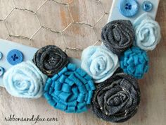 DIY felt and denim flowers on a chicken wire frame.