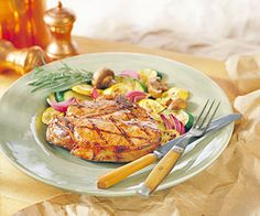 Thick pork chops sizzling on the grill have are a favorite summer dinner in Iowa. This slightly sweet marinade makes the juiciest chops ever.