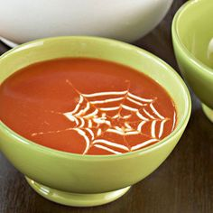 Spiderweb Soup  - Give boring tomato soup a ghoulish makeover. This tangled web is a bit of sour cream woven with a toothpickFor the spiderweb design, mix together 3 tablespoons of sour cream and 1 tablespoon of milk. Pour the mixture into a plastic condiment bottle. Carefully squeeze several circles on the surface of warm soup, making a targetlike design.