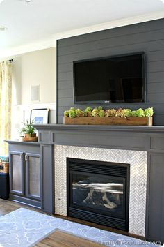 A gorgeous gray gas #fireplace complete with #DIY built ins and a #DIY plank wall!