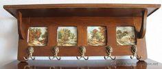 Antiguo perchero de roble holandés con cuatro azulejos de porcelana con cinco cabezas de leones, 350 €