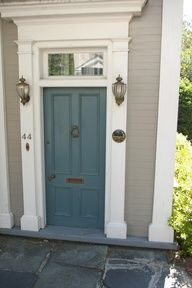 cool front door color, and lights flanking it