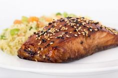 Balsamic-Glazed Salmon: 1 salmon fillet (2 pounds) cut into 6 serving pieces, or six pre-cut salmon fillets Salt and pepper 3 tablespoons honey 1/4 cup balsamic vinegar 2 cloves garlic, minced 1 tablespoon brown sugar 1 1/2 teaspoons sesame seeds