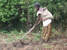 Beatrice and her baby work a small plot of land in order to grow crops for the local marketplace.