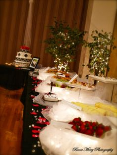 Beautifully decorated food table at a wedding reception