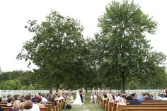 Southern wedding ceremony. Photo by Aaron Snow Photography. Rentals from Mood Party Rentals. #wedding #altar #outdoor #churchpews