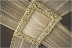 picture frame to hang draping from ceiling -- love this
