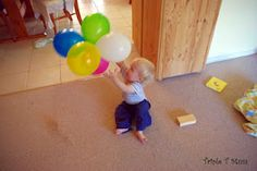 Balloon Cluster Fun. Cheap way to encourage gross motor skills in pre-walkers.