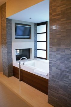 bathtub w. tv + fireplace. I would so never come out