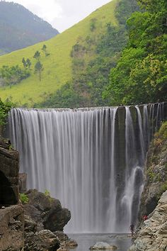 Reggae Falls, Jamaica    hey where is this??????  has some one imposed a waterfall on Jamaican hills?? I thought I knew most of Jamaica having travelled all over in my 40 years there But never saw these falls.  Who can help me?
