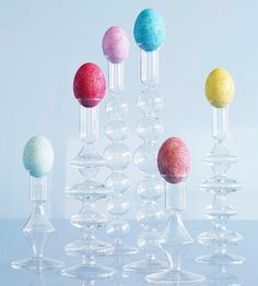 Show off your dyed eggs with unused candleholders. More pretty ways to decorate with eggs: http://www.bhg.com/holidays/easter/decorating/decorate-with-easter-eggs/?socsrc=bhgpin021413candlestickeggs=12