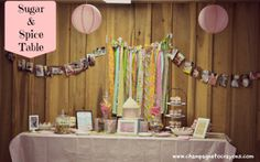 Sugar and Spice Birhtday party Table.  LOVE the picture garland.