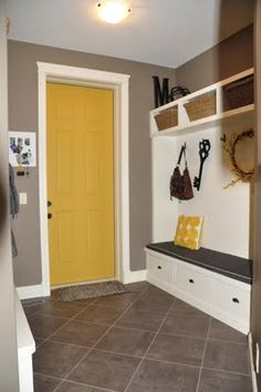 Great idea to paint the inside of a door to give a room a pop of color! And, love the bench and cubbies.