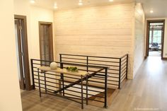Modern Staircase and white washed wood wall