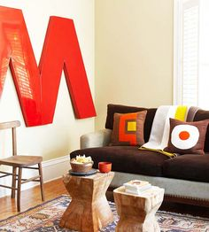 Like the big letter but wonder if I could do a chevron across with painted wood accents. DELISH!