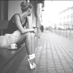 Who doesn't sit outside and ponder while wearing pointe shoes and having a cup of tea?