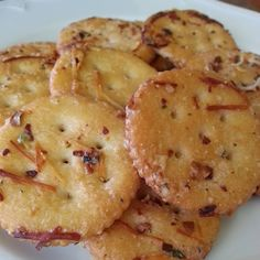 SPICY RANCH RITZ CRACKERS ~~~~ Customize your Ritz Crackers by tossing a box with 1 stick melted butter, 1 packet Ranch dressing mix, 1/4 c. grated Parmesan, 1 tbsp. red pepper flakes and 1 tsp. garlic powder. Bake in 300 degree oven for 15 minutes.