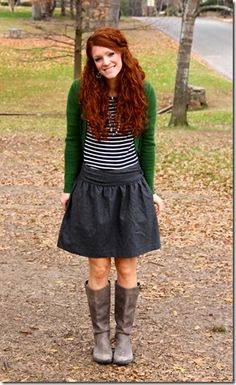 Striped shirt, gray skirt, boots, green cardigan.  Not crazy about those boots.