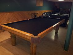 Hawthorn By Brunswick Pool Table older oak table in oak room with new black cloth for pool table More
