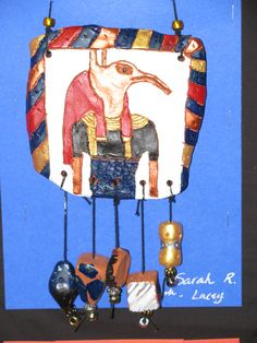"""4th grade ancient Egyptian style ceramic tablet with terra cotta beads; approx. 4"""" X 5""""; lesson by art teacher: Susan Joe"""