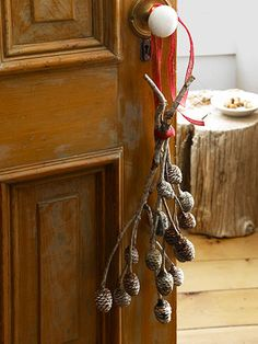 Smart! Use pine branches to decorate a door.