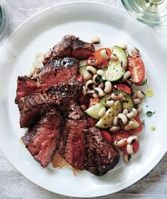 Seared Hanger Steaks With Black-Eyed Pea and Tomato Salad recipe: Serve the quick-cooking hanger steak with a side of black-eyed peas, tomatoes, and cucumber. weeknight dinner, salad recipes, grill, food, black eyed peas, tomato salad, hanger steak, sear hanger, blackey pea