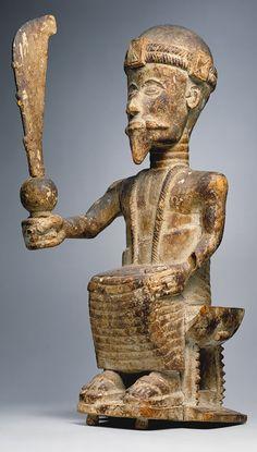 Seated Male Figure, 19th–20th century  Ghana; Akan  Wood, kaolin