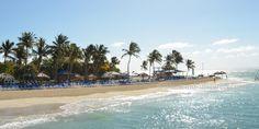 Panoramic view of the main beach front at Palomino Island.  El Conquistador Resort & Las Casitas Village. Puerto Rico  ElConResort.com