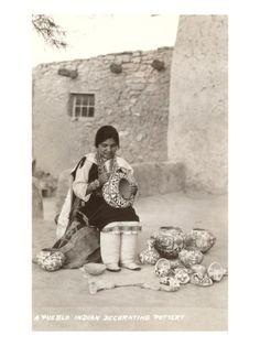 Acoma Pueblo Indian Woman Decorating Pottery.