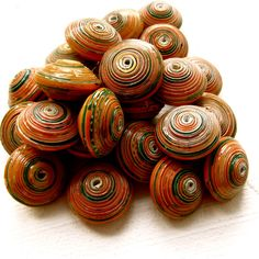 Big, Juicy fat recycled paper beads. One and a half times bigger than normal OMO. A mix of wonderful vibrant colours for all kinds of jewelry making and crafting. Length of bead varies. Sold packet containing 10 beads.    Buy now www.mzuribeads.com/     beads and jewelry