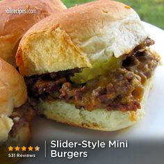 Slider-Style Mini Burgers | Cheesy, creamy seasoned ground beef is spread on dinner rolls for these party favorite burger sliders! Had these at a birthday party tonight and they were yummy!!! Thanks Em for the pin. :)
