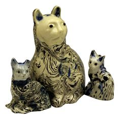 A collection of early English Staffordshire pottery figures of seated cats.