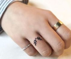 A thin tattoo on the ring finger.