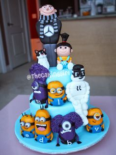 Despicable Me theme Cake! The Characters are all edible.  (with the Michelin Man and other details not related to the movie)  www.thecakinggirl.ca  #despicableme #agnes #cute #cake #cakes #gumpaste #minions #fondant #thecakinggirl #colorful #creative #edible #figurines #sweettooth #despicable #diy #handmade #gru #purple #purpleminions