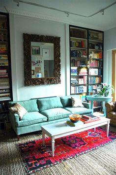 family room bookshelves and mirror