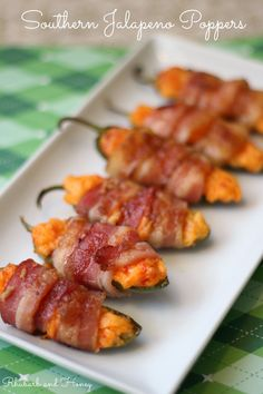 Spicy jalapenos stuffed to the gills with ooey, gooey pimento cheese, then wrapped with copious amounts of bacon