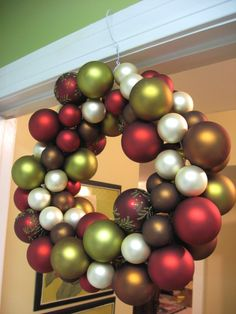 Made using a wire hanger and christmas balls