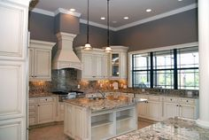 kitchen with antique white cabinets | Off-white kitchen cabinets with antique finish | Home