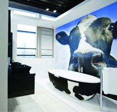 Could be one of the craziest bathroom themes I have ever seen... could you relax with a cow in the room? :)