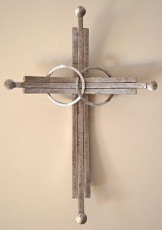 A wedding cross made from recycled industrial scrap iron. To see more crosses, visit http://www.etsy.com/shop/CrossesByCatherine. To read my testimony, visit crossesbycatherine.com