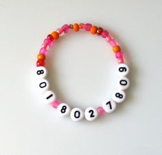Find-Me-Fast: Phone Number Safety Bracelet ( mom's cell phone number bracelet, when traveling with little ones in airports, at amusement parks, school Field Trips, etc.)