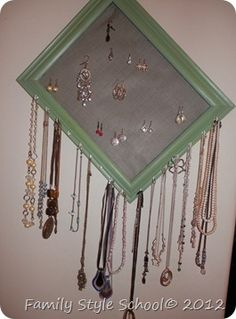 Homemade jewelry holder using an old picture frame and screen.  CHEAP and SIMPLE!