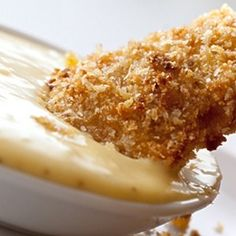 Tender chicken strips marinated in homemade honey mustard dressing, dredged in bread crumbs and baked until golden.