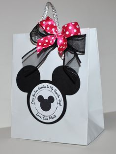 Deb's Party Designs - Minnie Mouse Favor Bag (Inspired) , $1.25 (http://www.debspartydesigns.com/copy-of-minnie-mouse-favor-tags-inspired/)